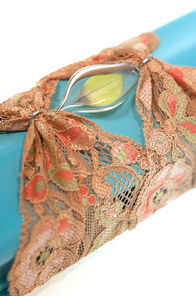 Salmon lace cuff with parakeet feather