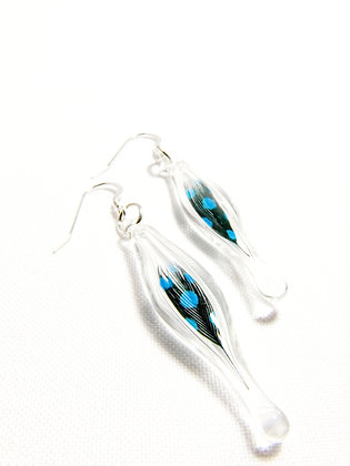 Glass capsule earrings with blue dotted feathers