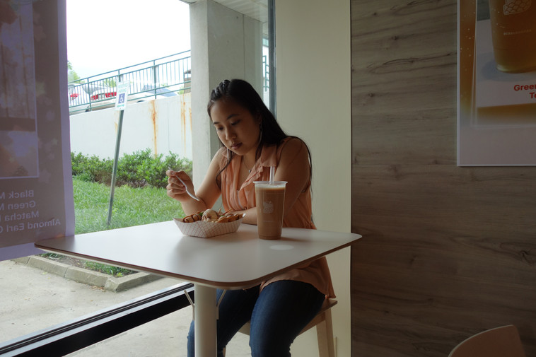 Girl Enjoying Egg Waffles and Milk Tea