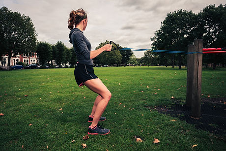 A young woman is exercising and working
