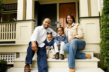 family-front-steps-house-porch-home-buye