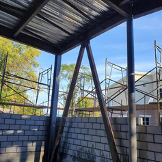 Steel framing and cement block wall
