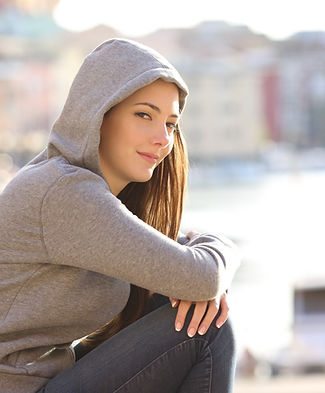 Photo of a cool girl sitting and smiling