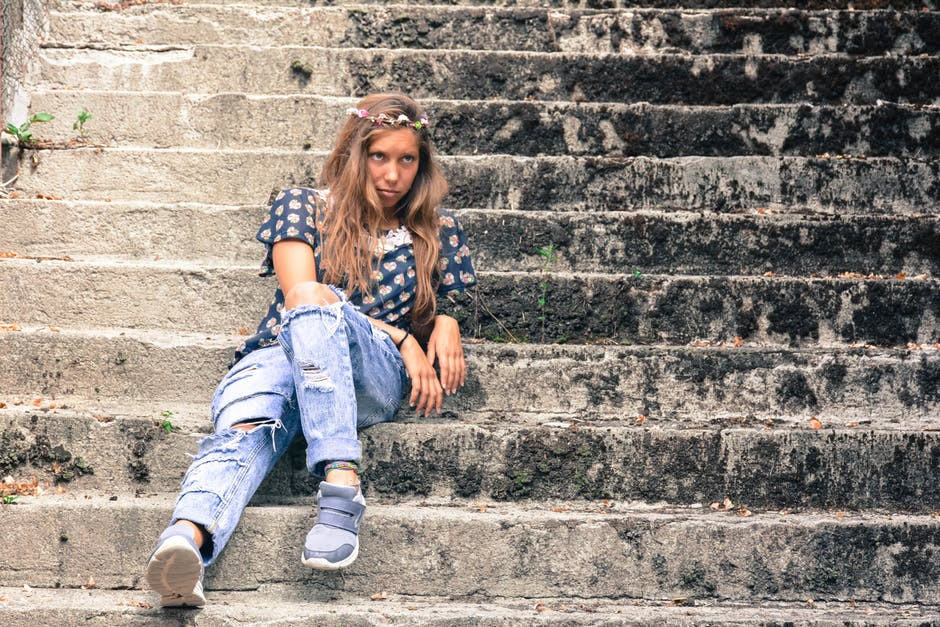 Woman sulking on the stairs