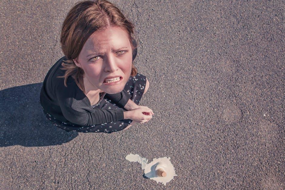 Upset woman dropped ice-cream cone