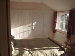 East wing pink bedroom cupboards