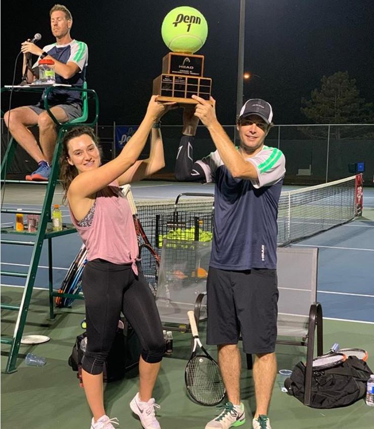 Devin & Coulter Raise Trophy