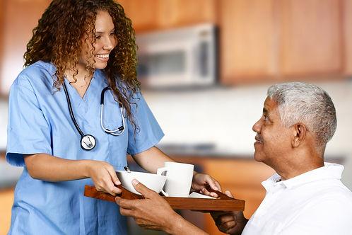 Health care worker helping an elderly ma