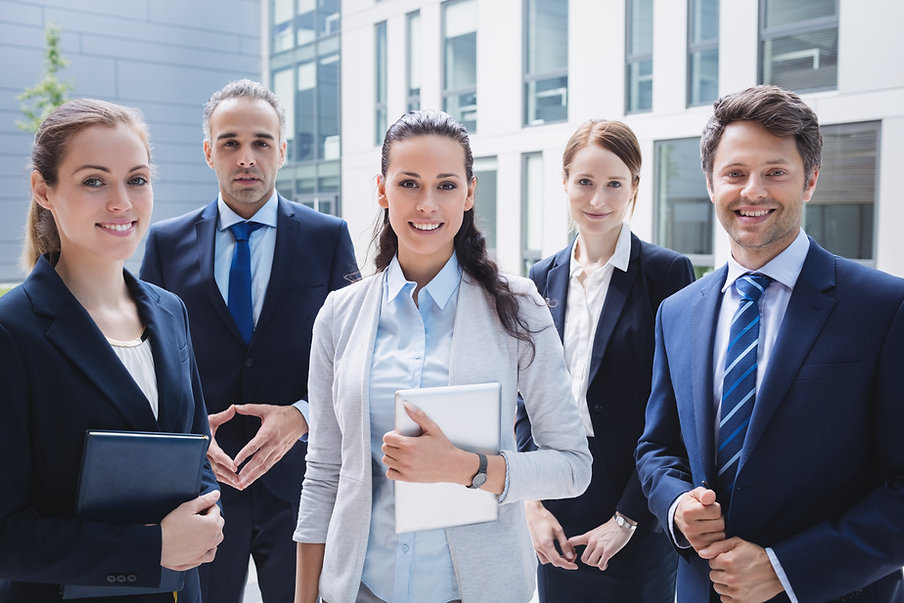 confident-businesspeople-standing-outsid