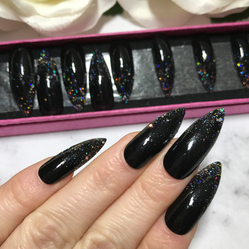 These Stiletto Nails Are Black With Silver Glitter Tip