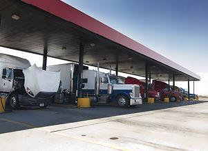 Trucks At Gas Pump Station Off Highway.jpg