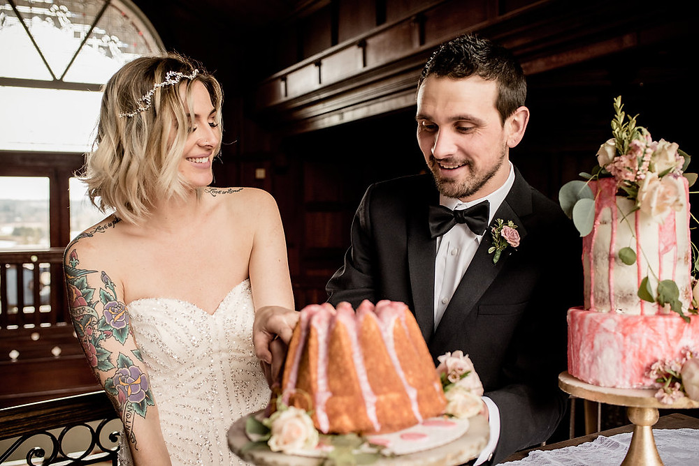 The Tradition of Marketing in the Wedding Industry | Bride and Groom Cake-Cutting at Graystone Castle | Snohomish Wedding Coordinator