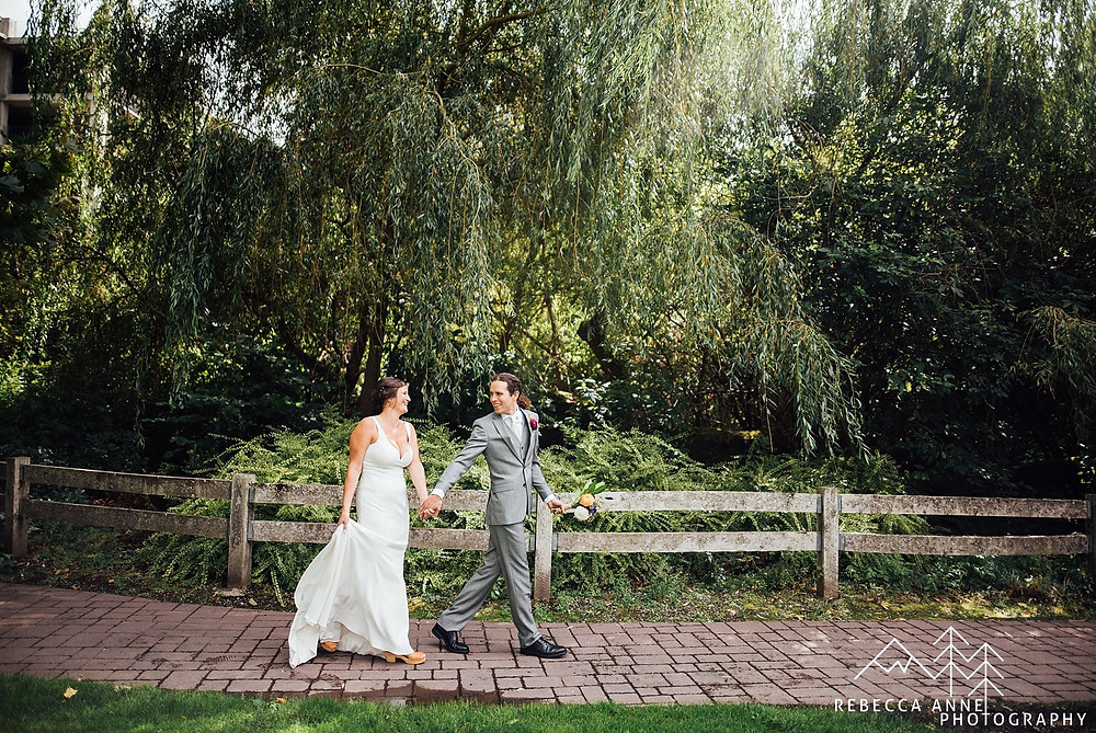 Pickering Barn Outdoor Wedding | Bride and Groom Stroll Through the Garden |  Snohomish Wedding Coordinator