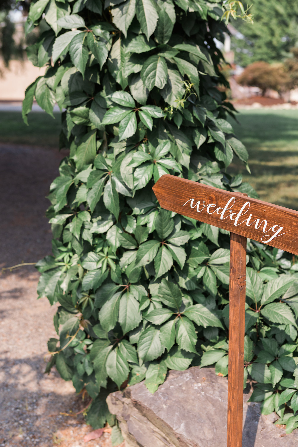 Realistic Wedding Planning on a $15k Budget |  Wood Wedding Sign and Greenery Arch |  Snohomish Wedding Planner
