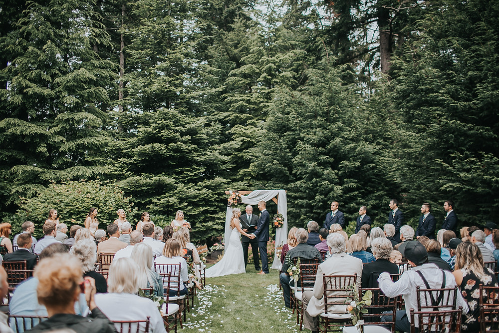 Find a Wedding Advocate | Evergreen Gardens Outdoor Ceremony with Bride and Groom at Arbor | Snohomish Wedding Planner
