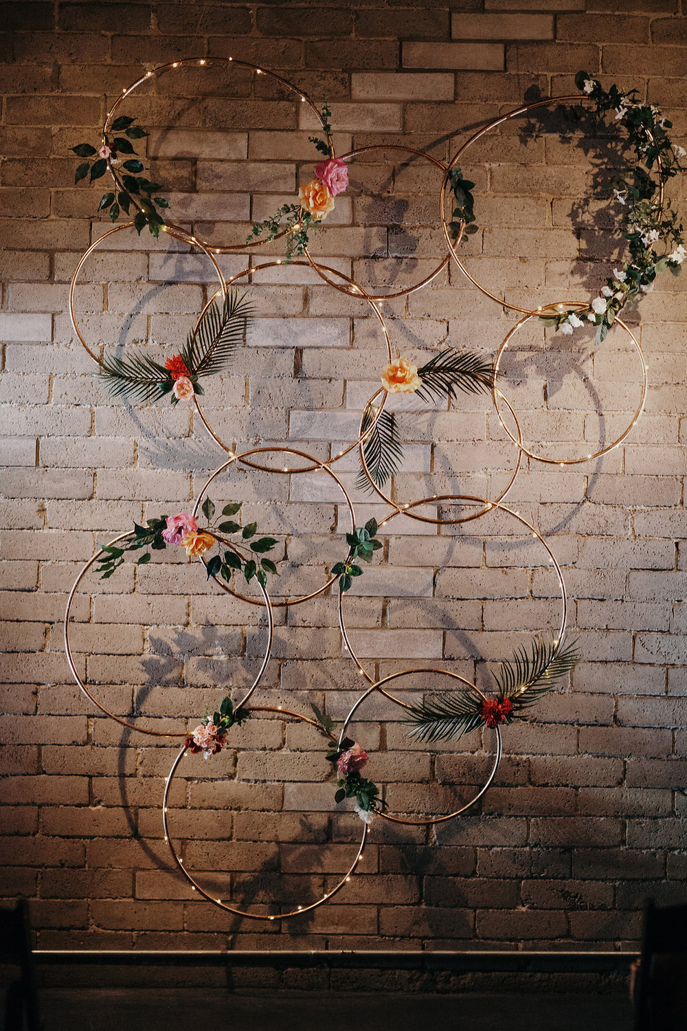 Wildflowers Within Sodo | Gold Hoops and Silk Flowers Ceremony Backdrop | Snohomish and Seattle Wedding Coordinator