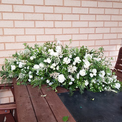 White & Green Casket Flowers
