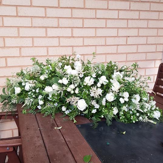 White & Green Casket Flowers