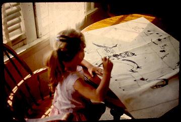 Me sketching at table.jpg