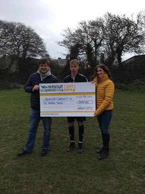 Ashley being presented with a cheque from Harbour Lights