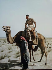 Auto Glass Combat Vet Owner John Young in Gulf war on a camel.
