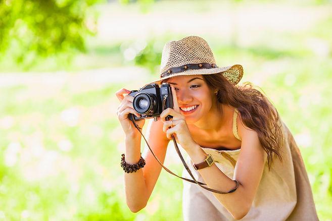 Woman_taking_photo_camera_Depositphotos_