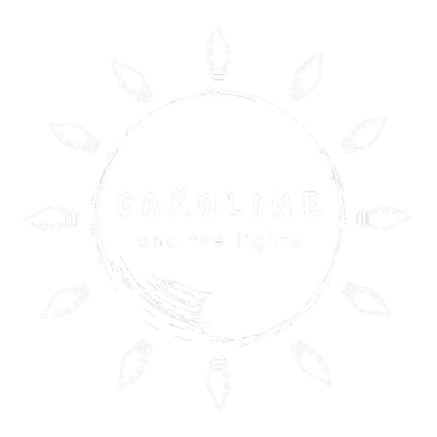 Logo: Sketched sun with centred text  'Caroline & the Lights'