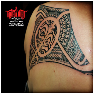 Polynesian back tattoo by Andy