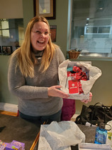 Lesley joyously displays her filled box