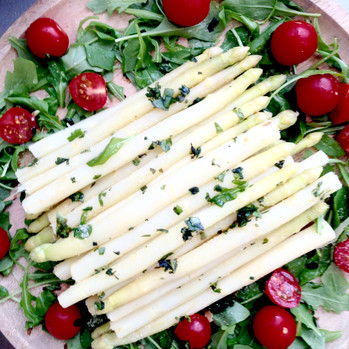 Served with the Three Cheeses: Blanched Asparagus with a Drizzle of Spiced Olive Oil, Fresh Basil, Cherry Tomatoes, Lemon & Nooch