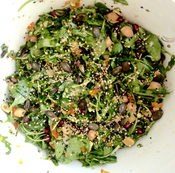 A Handsomely Dressed Salad:  Rukola, Parsely, Coriander, Chickpeas Pomegranite, Yellow Peppers, Seeds, and the surprise guest: Za'atar~