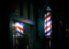 Barber shop pole by the entrance lights