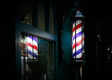 Barber shop pole by the entrance lights