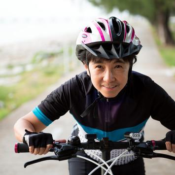 joyful-senior-woman-riding-a-bicycle-P67