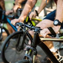 group-of-seniors-biking-in-the-park-6L7X