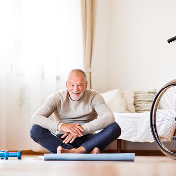 senior-man-doing-exercise-at-home-PCMEAR