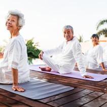 group-of-seniors-practicing-yoga-7DV3EMW