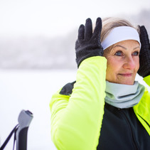senior-woman-getting-ready-for-skiing-PL