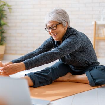 senior-woman-exercising-at-home-EFN2N75.