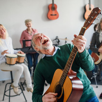 group-of-senior-people-playing-musical-i