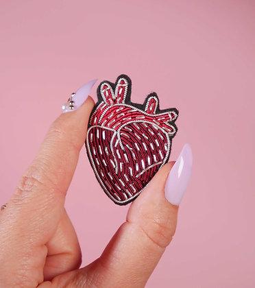 Broche cœur humain