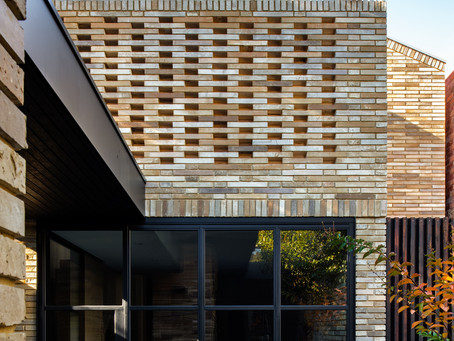 A unique Krause Emperor brick blend creates an aged woven tapestry at Gallery House