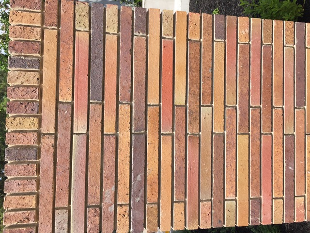 One row of bricks is recessed, creating a pattern