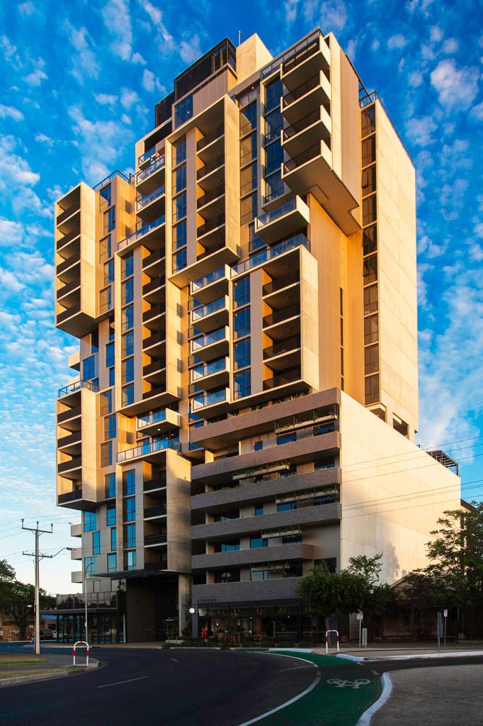 Bohem Apartments, brick inlay facade, Midnight Blue brick tiles