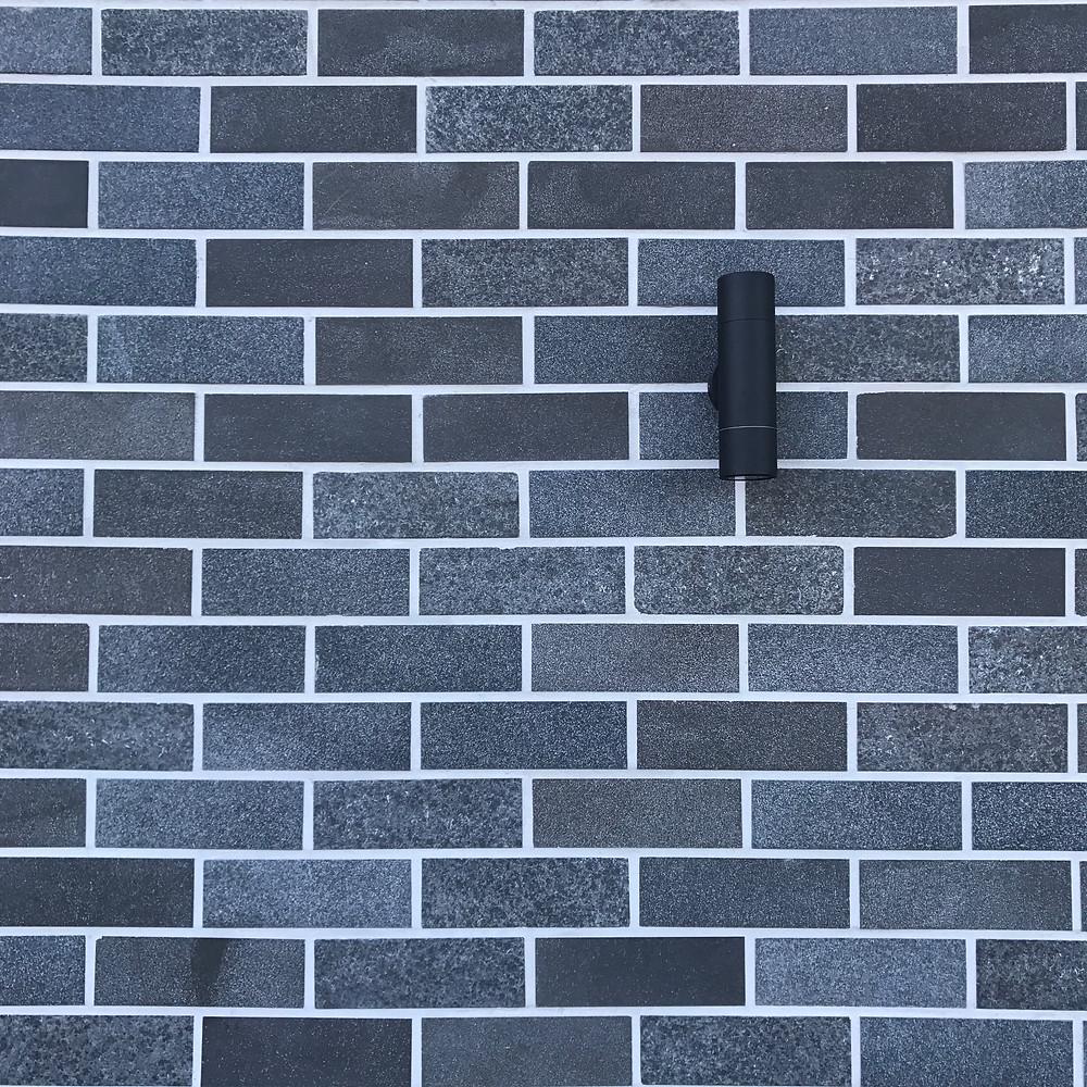 Grey brick tile facade