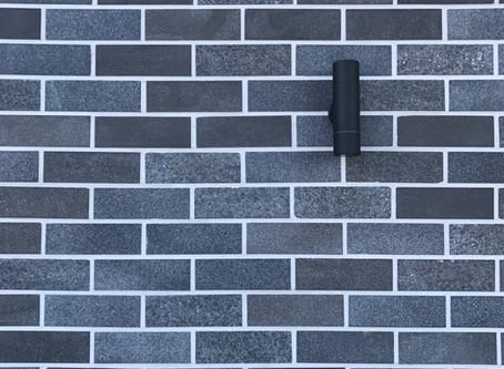 A unique blend of stone brick tiles balances art deco heritage with modern contemporary design