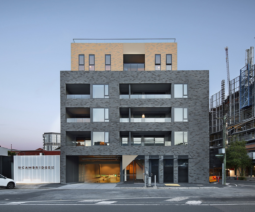 Brick Inlay Facade System, featuring a custom stone brick tile blend