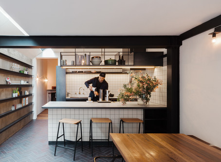 Midnight Blue brick tiles add strength and humility to Double Life House