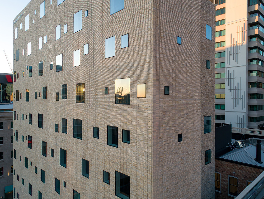 Brick Inlay facade, custom Krause grey brick tile blend