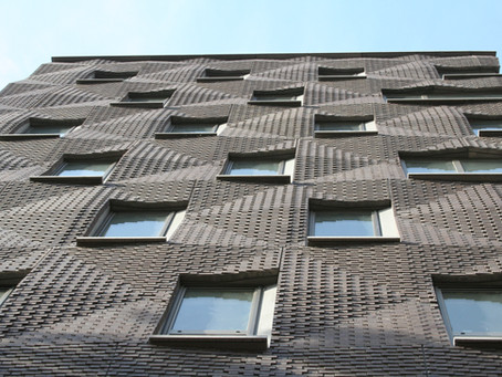 A rippled brick facade stops traffic in New York City